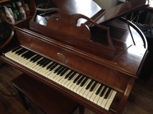 late 60's wurlitzer electric piano in a butterfly grand case